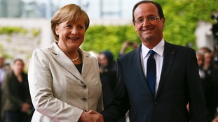 Angela Merkel and Francois Hollande meet for the first time in Berlin