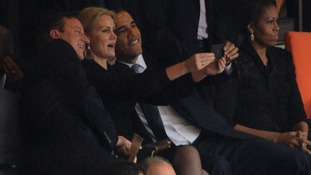 President Obama, David Cameron and Helle Thorning-Schmidt take a picture of themselves during the memorial.