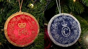 The specially-made royal trinkets hung on the tree by the Queen and Camilla.