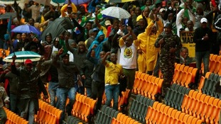 People run through rows of seats at Mandela's memorial