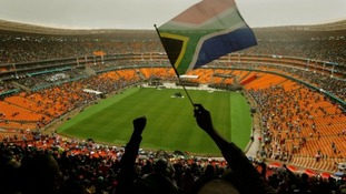 A man waves a South African flag during the memorial service.