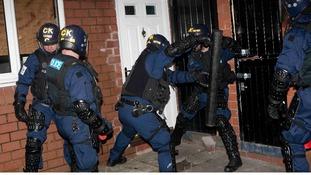 Police smashing door