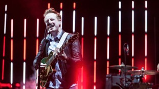 Two Door Cinema Club, led by lead singer Alex Trimble, will headline the 2014 Latitude Festival.