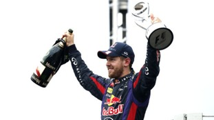 Sebastian Vettel celebrates winning last season's final race in Brazil.