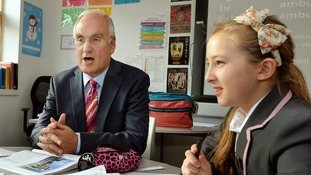 Sir Michael Wilshaw, the Head of OFSTED, talks to students as he visits the St Paul's Way Trust School in east London.