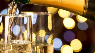 Glasses of champagne and present for special occasion gold decoration.