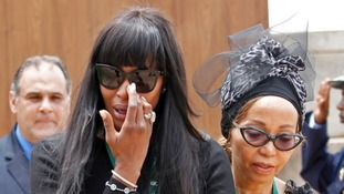 Supermodel Naomi Campbell reacts after viewing the coffin of Mandela.