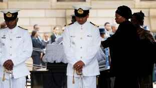 Graca Machel, Nelson Mandela's widow, visits his coffin in Pretoria.
