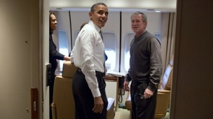 President Barack Obama jokes with former President George W. Bush shortly after boarding Air Force One for the trip to South Africa.