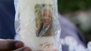 Mandela's visage adorns everything from candles and scarves to t-shirts and posters.