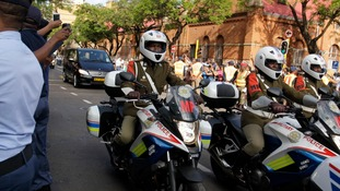 The funeral cortege carrying Nelson Mandela being escorted through the streets of Pretoria.