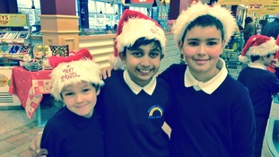 Children help pack bags for the Text Santa appeal
