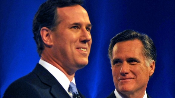 Rick Santorum (L) and Mitt Romney