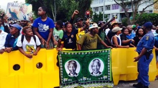 The crowd had been dancing and shouting 'Viva' as they waited to see Nelson Mandela.
