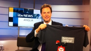 Deputy Prime Minister Nick Clegg poses with a Text Santa t-shirt.