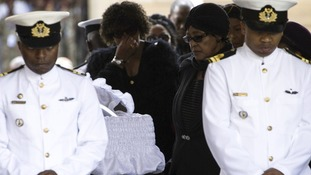 Winnie Mandela pays her respects at Nelson Mandela's coffin as he lies in state at the Union Buildings in Pretoria.