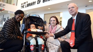 Joanna Kucper, with her baby, Lewis Reynolds, with Library marketing assistant Adela Earlington (far left) and director Brian Gambles