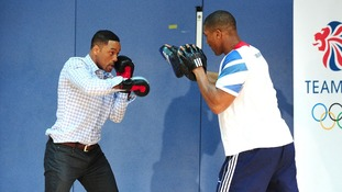 Will Smith (left) doing pad work with Anthony Joshua, GB Super Heavyweight boxer.