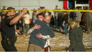 Emotional scenes after the shooting at a Colorado high school