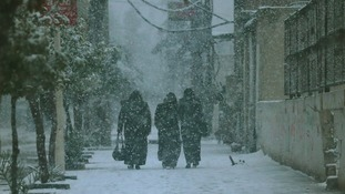 Damascus residents in a rare snowstorm