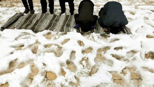 Palestinians pray after a heavy snowfall brought by Mediterranean storm Alexa