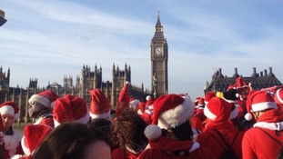 Santacon revellers congregate near the Palace of Westminster for their annual celebration