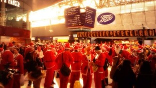 Santacon revellers gather at Waterloo station, as snapped by ITV News weather presenter Lucy Verasamy