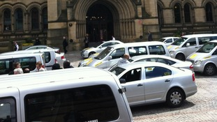 Private hire taxis surrounding Manchester Town Hall