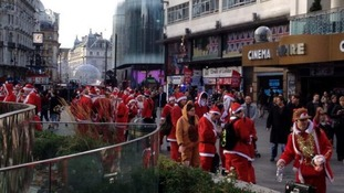 Santa revellers gathering in London's Leicester Square