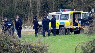 Officers gather in fields near Upton, Oxfordshire in their search for the missing teenager.