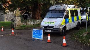 Police cordon off an area by the church in Upton, Oxfordshire, amid a continuing search for Jayden Parkinson.