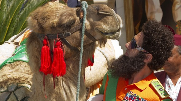 Actor Sacha Baron Cohen poses with a a camel during a photo call for The Dictator at the 65th international film festival, in Cannes