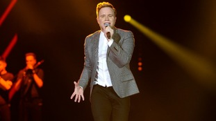 Olly Murs performing on stage during the 2013 Capital FM Jingle Bell Ball at the O2 Arena.