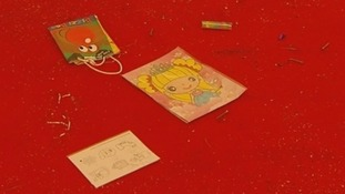 Some of the gifts the children received lie strewn on the floor.