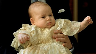 Prince George of Cambridge pictured wearing the hand-made gown in October.