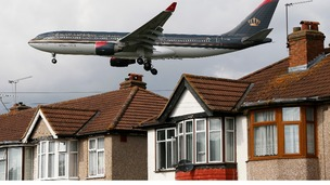 A Royal Jordanian airways jet arrives over the top of houses to land at Heathrow Airport in west London.