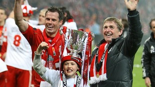 Kenny Dalglish (right) and Jamie Carragher (left) celebrate