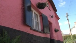 Pink house gets a muted makeover