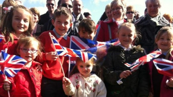 Children prepare to welcome the royals in Burnley