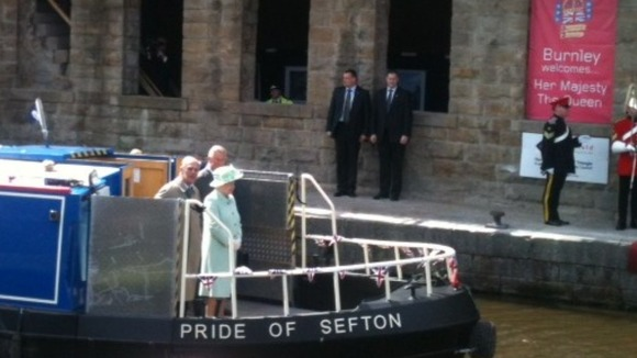 The Queen, Duke and Prince aboard a canal barge