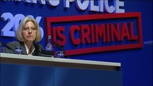 Home Secretary Theresa May on the podium of the Police Federation Conference