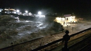 Cromer Pier hit by the storm surge.