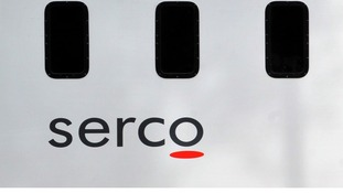 File photo of a prison van with Serco's logo on the side.