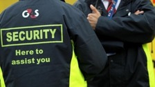 Men in G4S security coats.