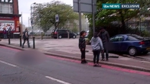Two women  try to reason with one of Lee Rigby's murderers in the immediate aftermath of the attack