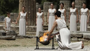 The Olympic Flame was lit in Olympia by an actress playing the role of High Priestess