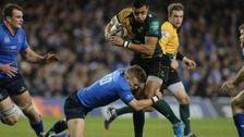Luther Burrell attempts to break through the Leinster defensive line.