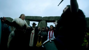 Druids attend the Winter Solstice service at Stonehenge