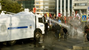 Police fire water cannon at Turkish protestors