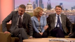 Rory Bremner (L) and Peter Mandelson react after defence minister Anna Soubry's comment